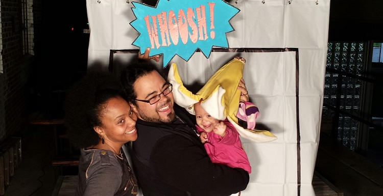 Durham Comics Project participants enjoy the pop-up photo booth at the DCP release party, 2014.