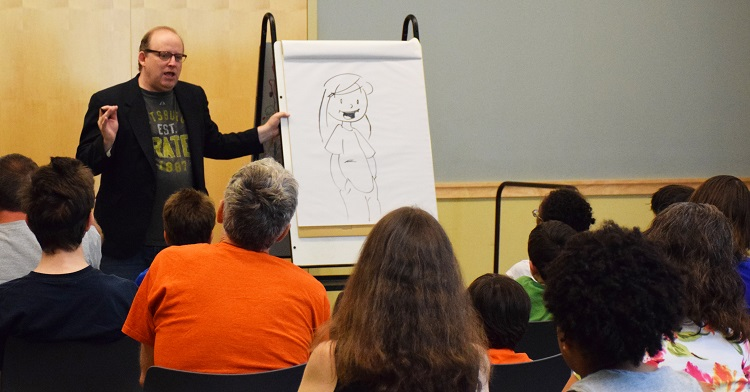 Jimmy Gownley demonstrates character design to a multigenerational crowd, 2015.
